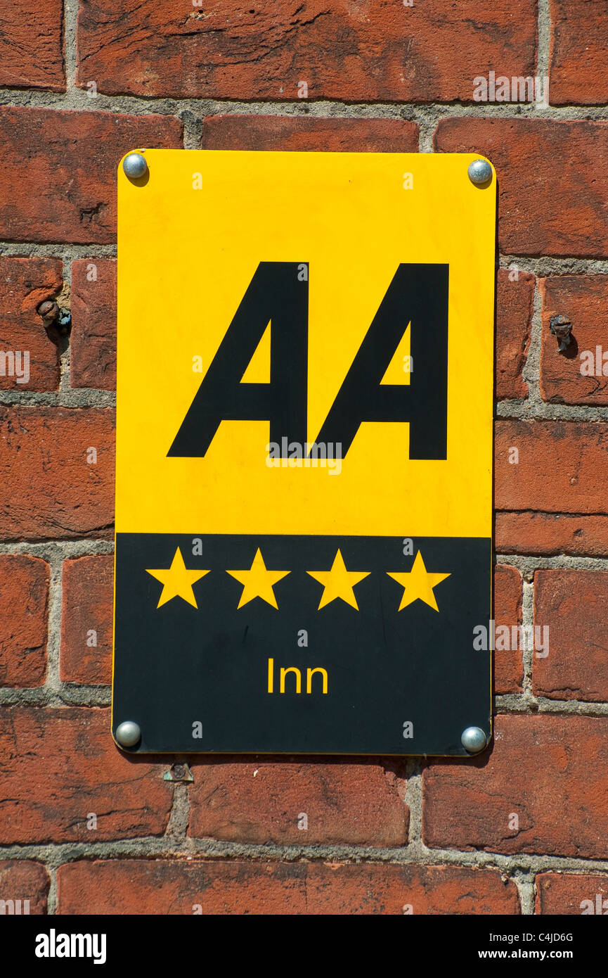 AA sign on the side of an inn showing it has a four star rating. Stock Photo