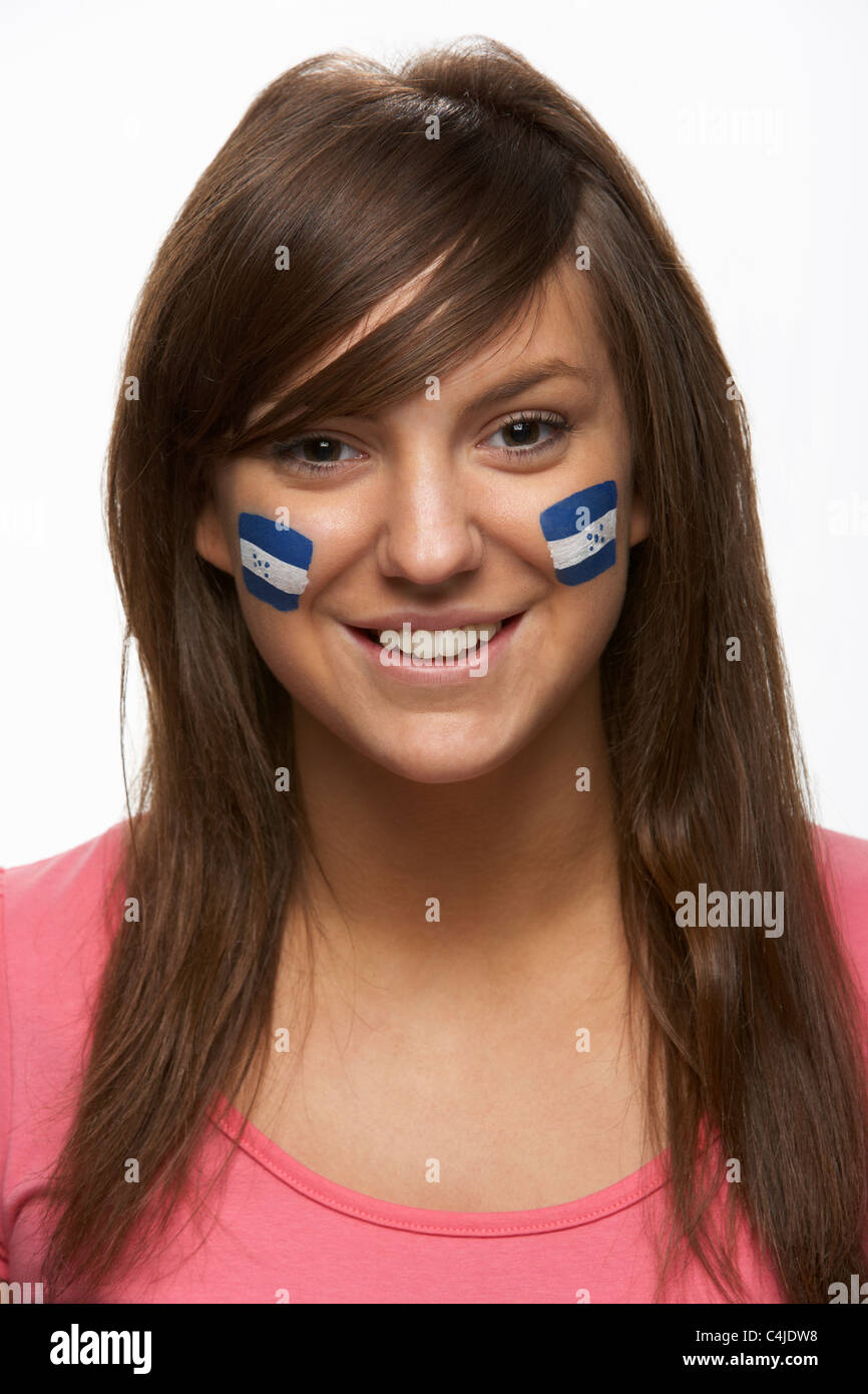 Young Female Sports Fan With Honduran Flag Painted On Face - Stock Image