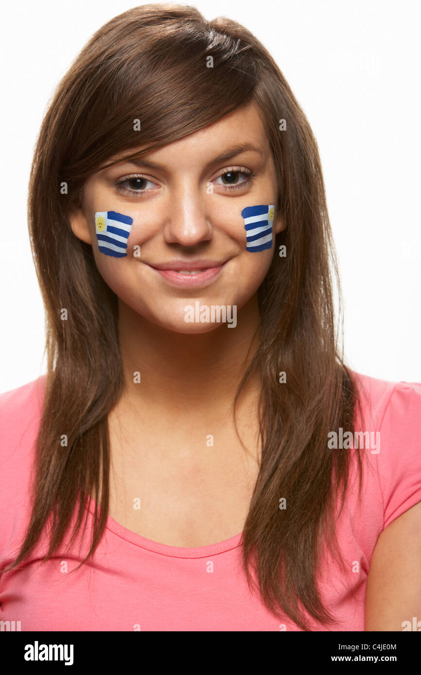 Young Female Sports Fan With Uruguayan Flag Painted On Face - Stock Image