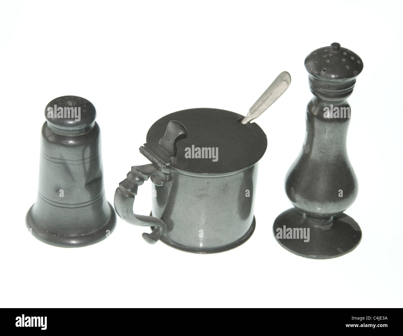 An antique pewter cruet set. Pepper salt and mustard. - Stock Image