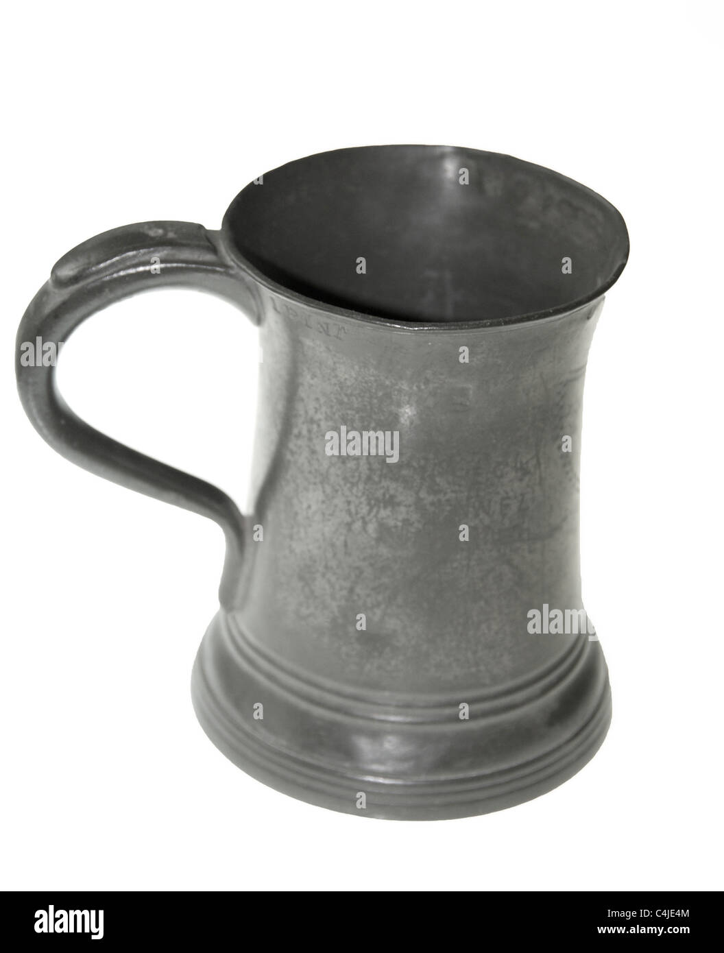 An antique one pint pewter beer tankard. - Stock Image