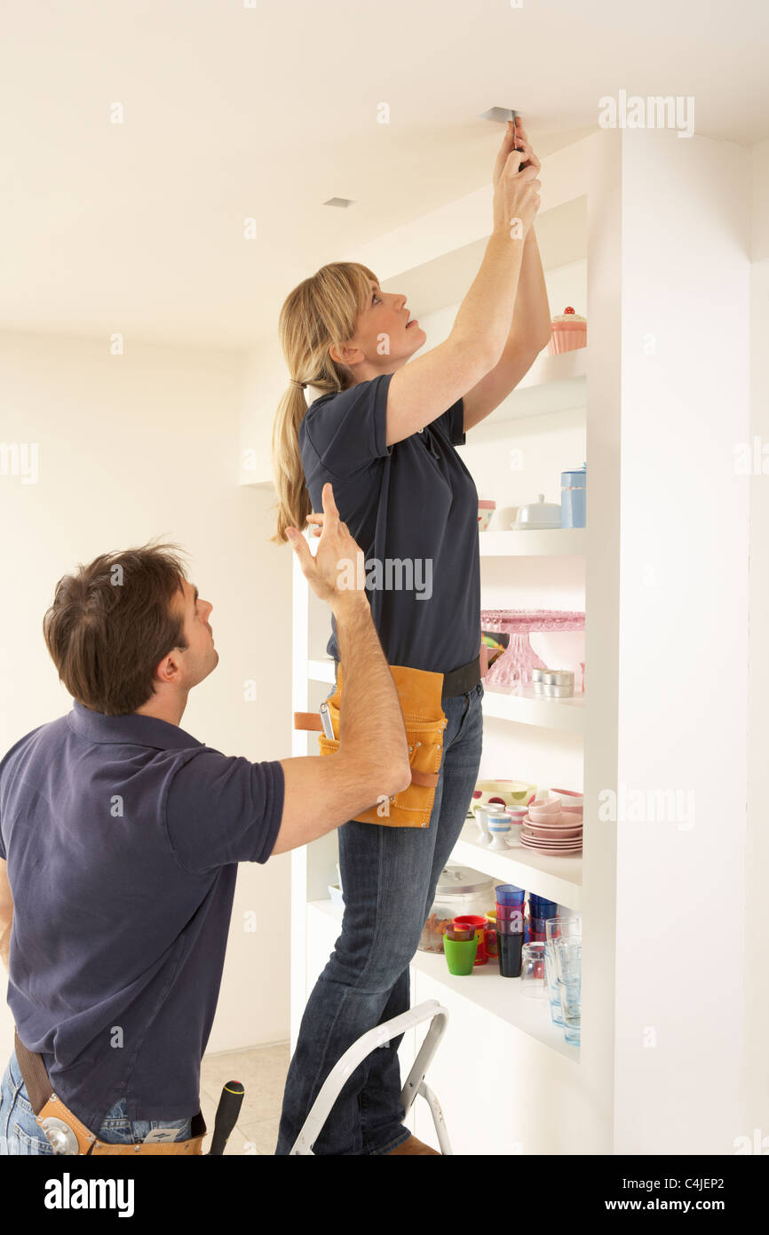Ceiling Light Fitting Stock Photos Wiring A Electrician Teaching Apprentice To Install In Home Image