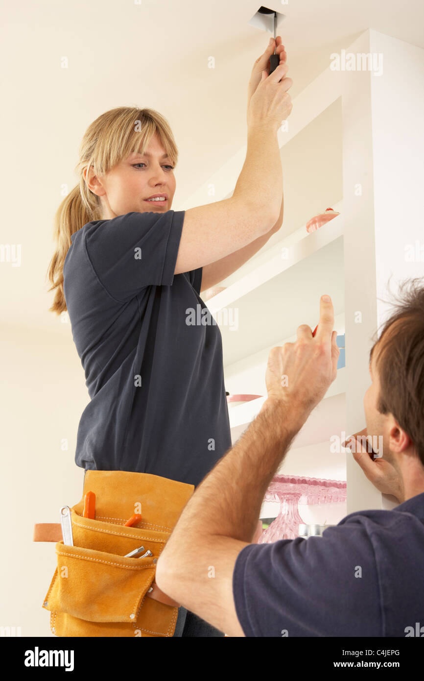 Woman Fixing Ceiling Light Stock Photos Wiring A Fitting Electrician Teaching Apprentice To Install In Home Image