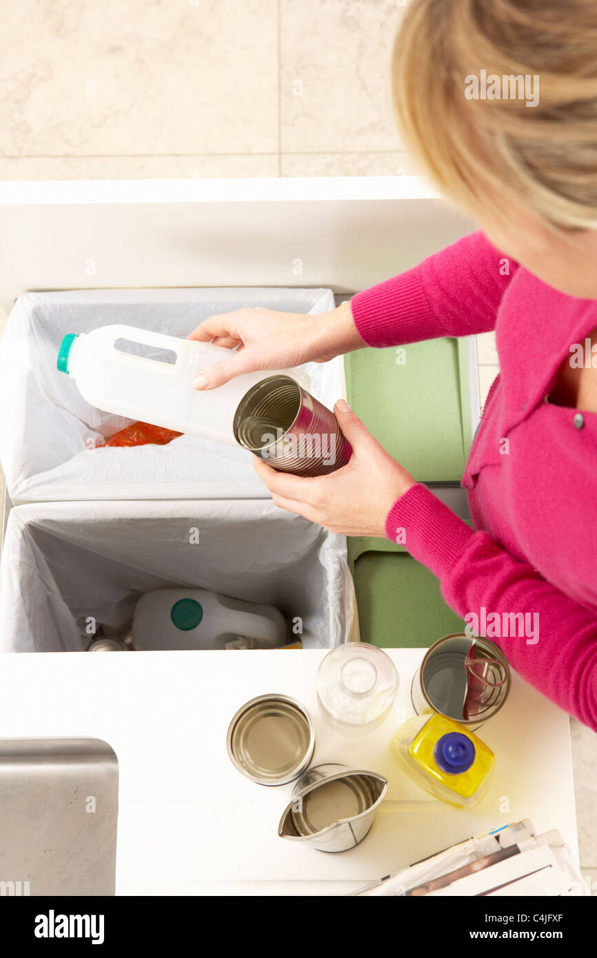 Woman Recyling Waste At Home - Stock Image