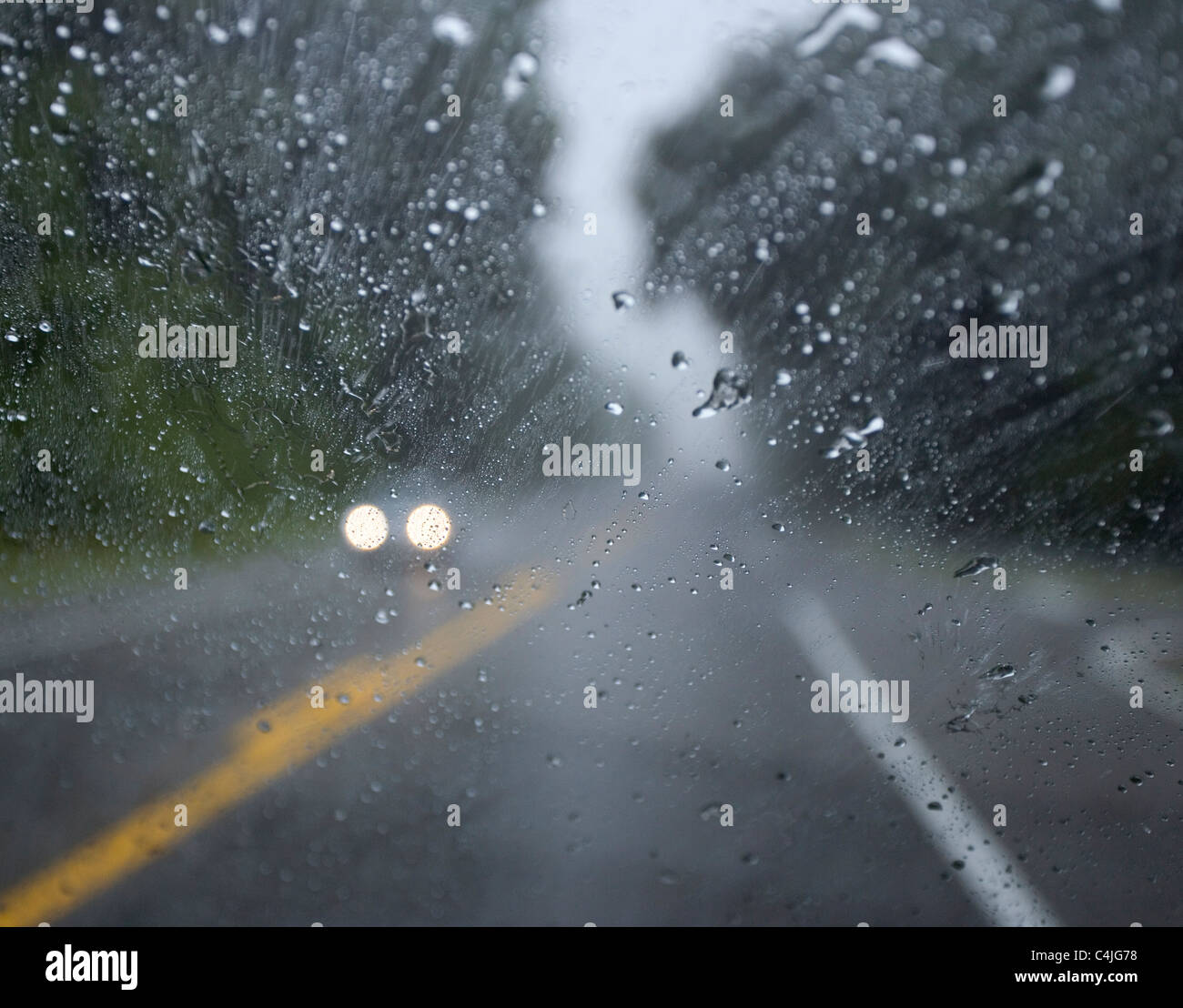 Truck Headlights In Rain : Wet road car headlights stock photos