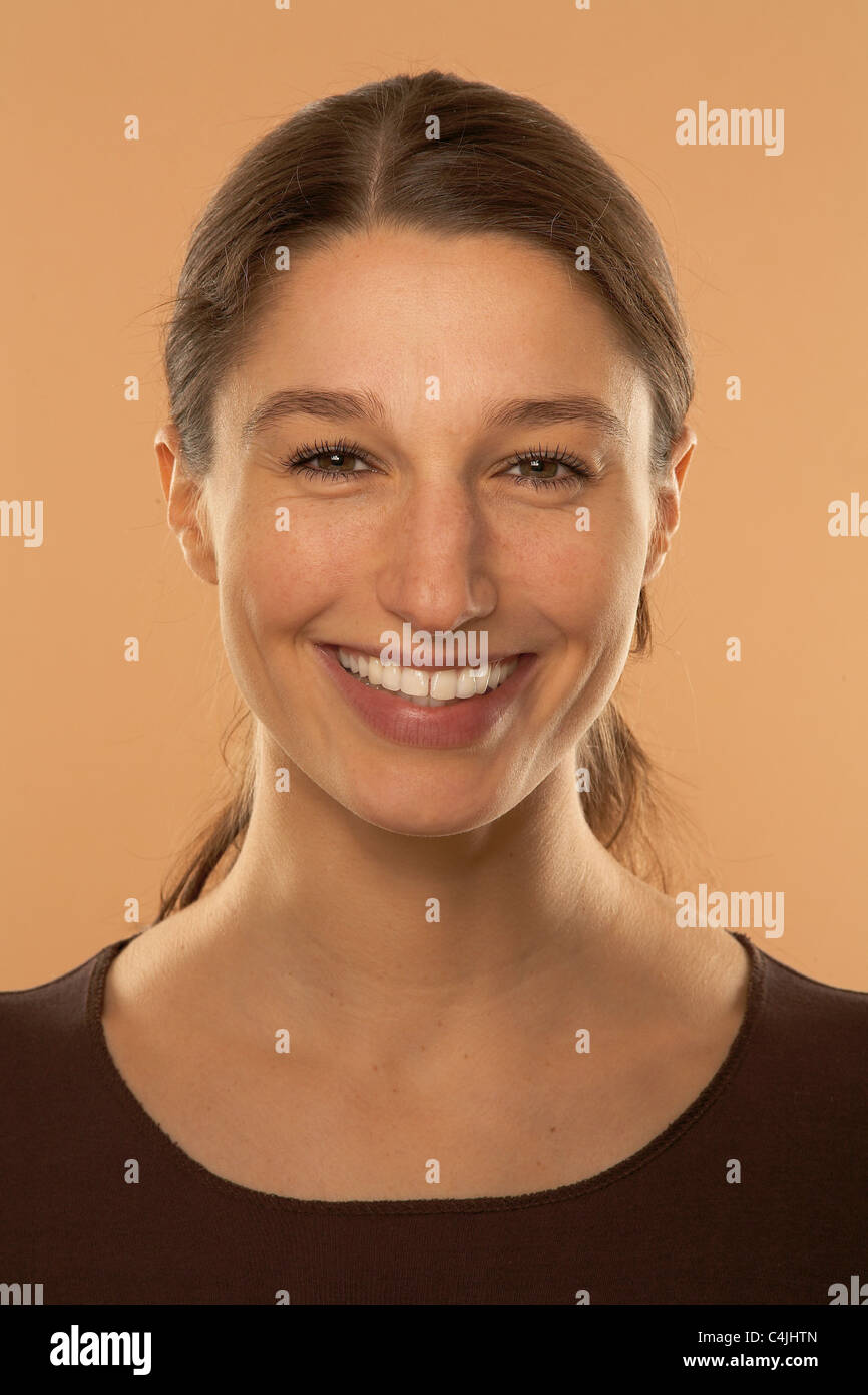 Woman laughs at camera - Stock Image