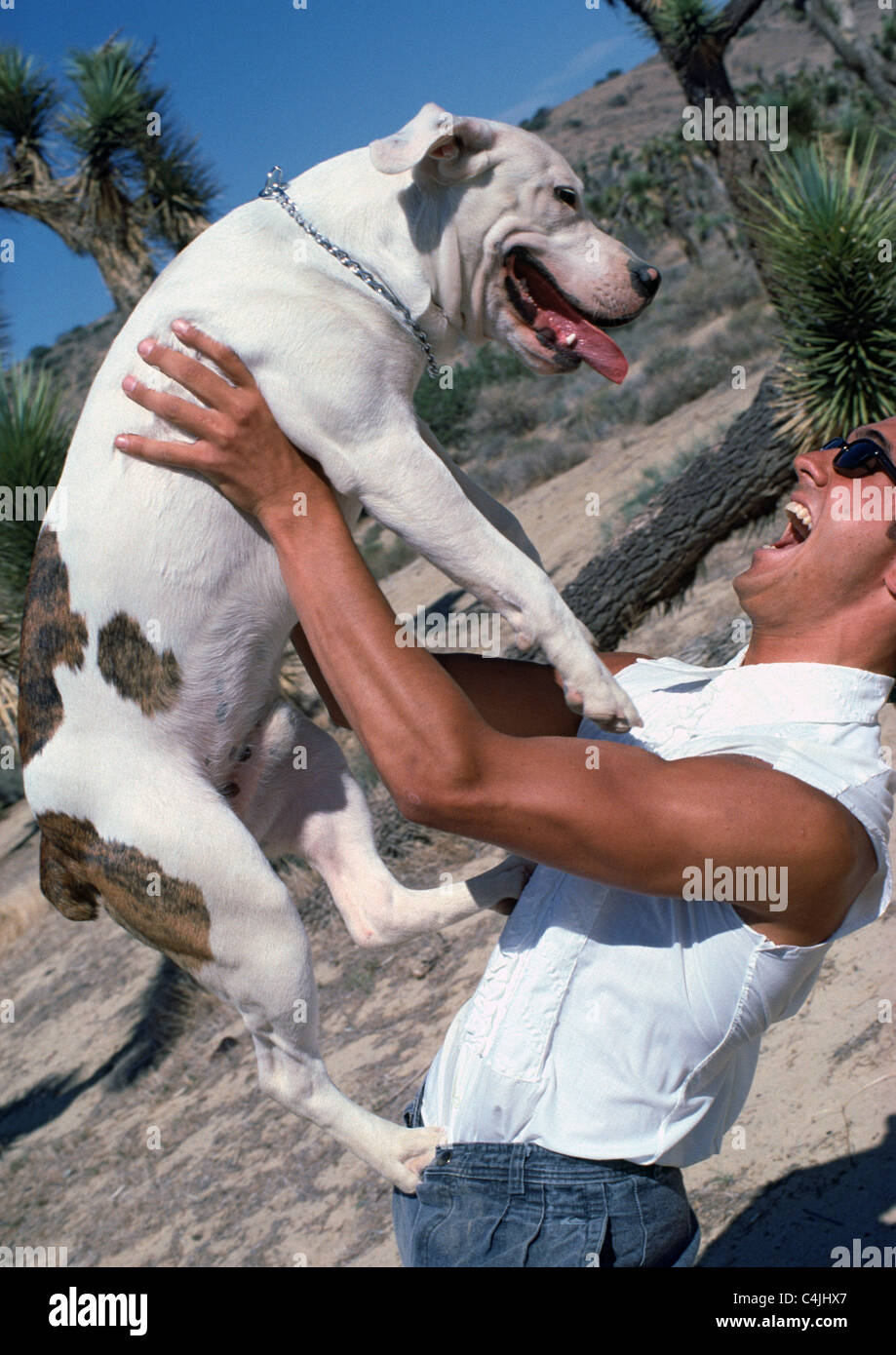 man playing with his dog - Stock Image