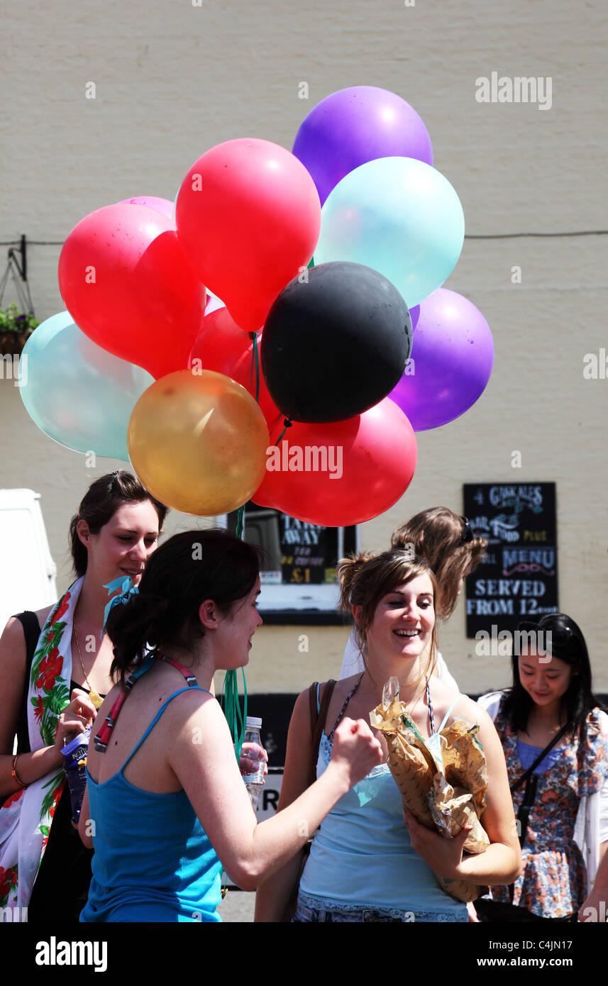 Balloon girl celebrating - Stock Image