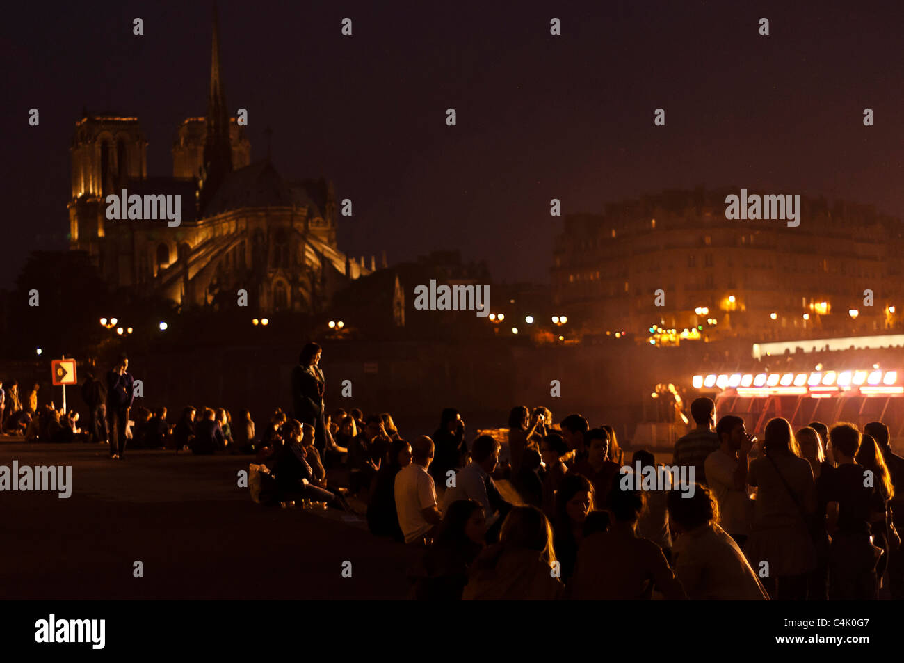 Young people having nice time in the Seine river, Paris, France. - Stock Image