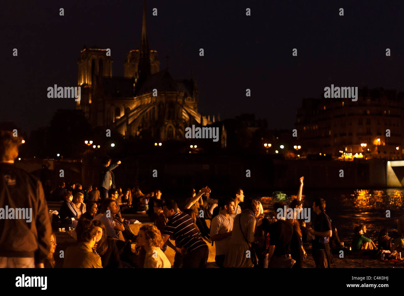 Young people having nice time in the Seine river, Paris, France. Stock Photo