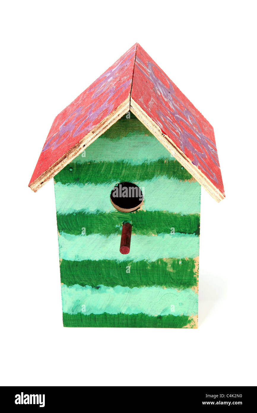 Colorful birdhouse painted by children over white background - Stock Image