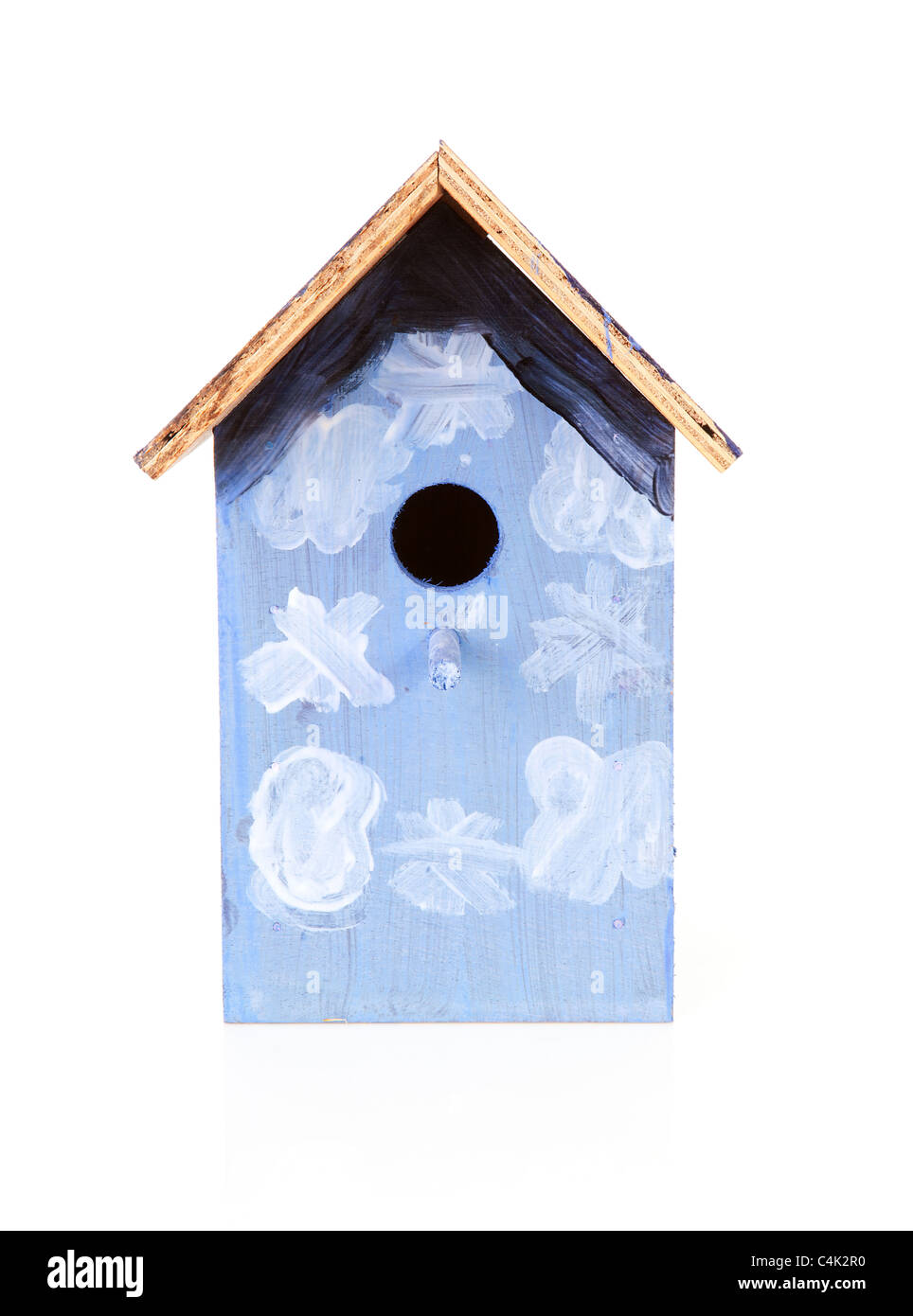 blue birdhouse painted by children over white background - Stock Image