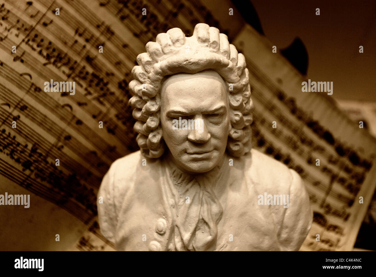 A plaster cast of the famous German composer, organist, harpsichordist and violist Johann Sebastian Bach in front - Stock Image