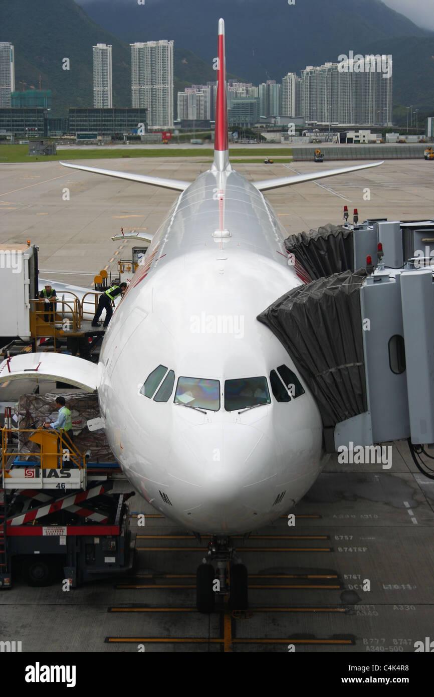 Swiss plane chek lap kok airport hong kong - Stock Image