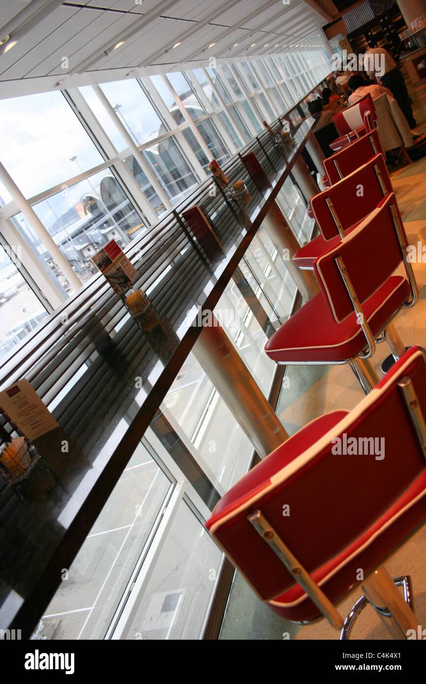 chek lap kok airport bar stools interior - Stock Image