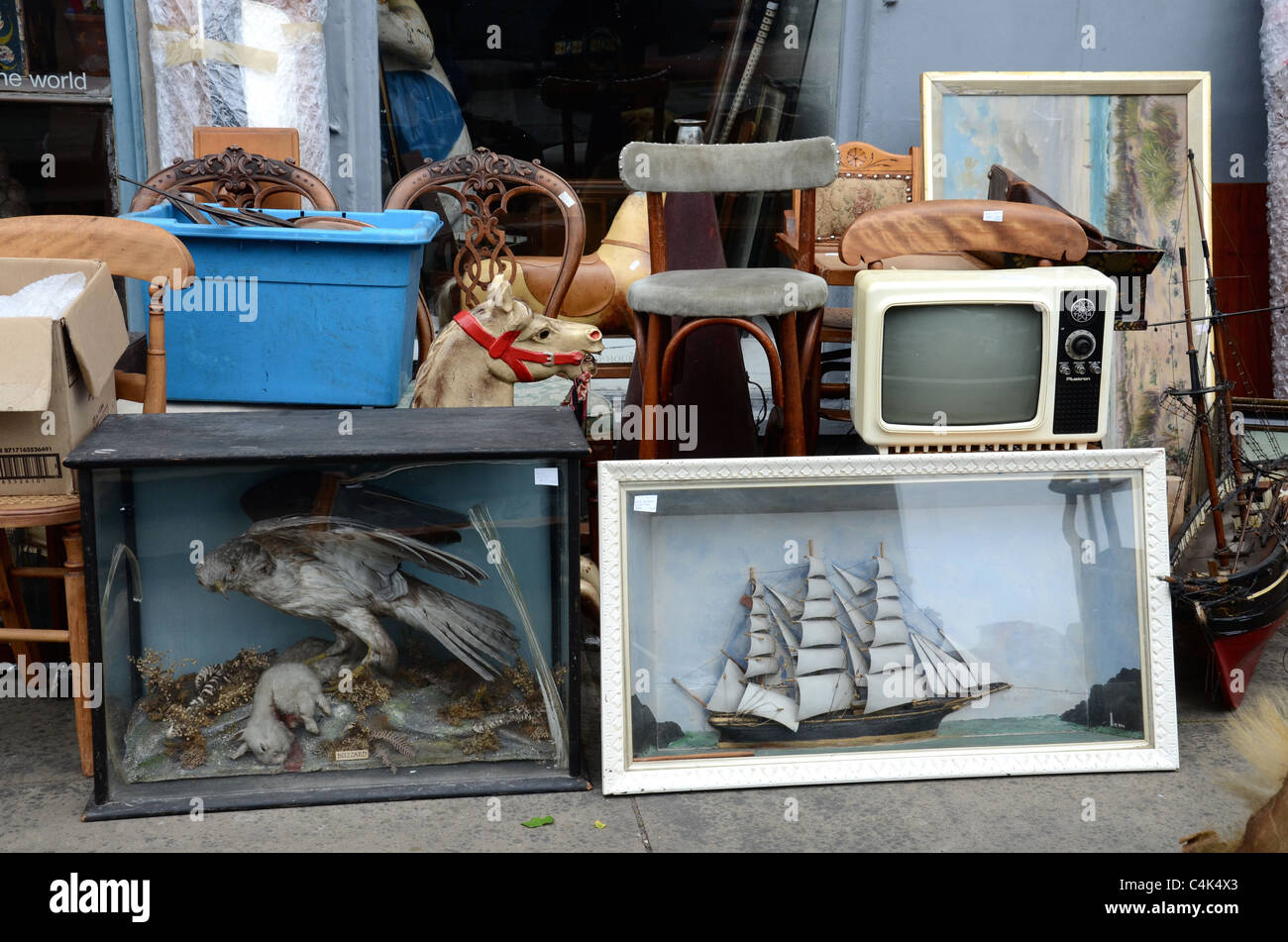 Various pieces of bric-a-brac outside an antique shop in Edinburgh's New Town. - Stock Image