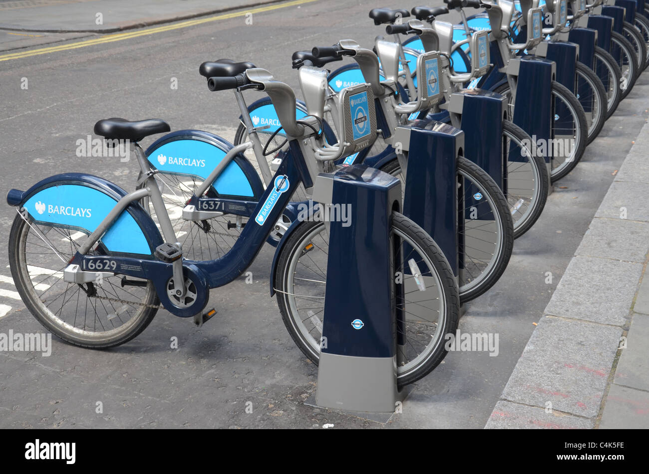 Barclays Transport for London Cycling scheme cycles in a bicycle rack for hire. - Stock Image