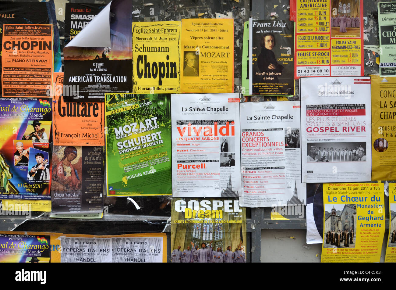 Adverts for a variety of classical music and gospel concerts on a wall in Paris, France. - Stock Image