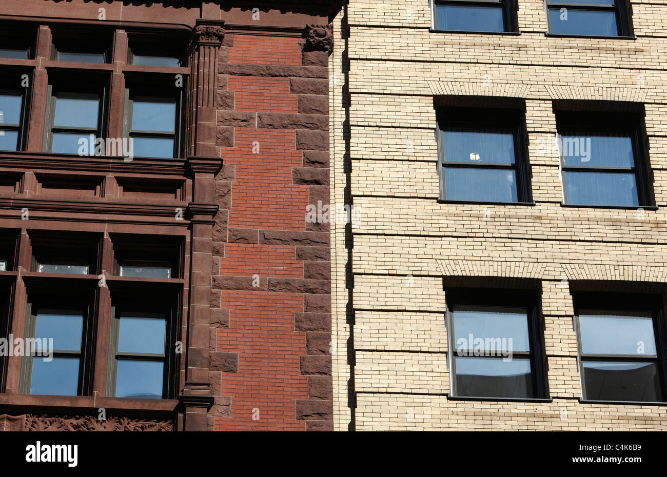 two types of brick buildings side by side in Boston - Stock Image