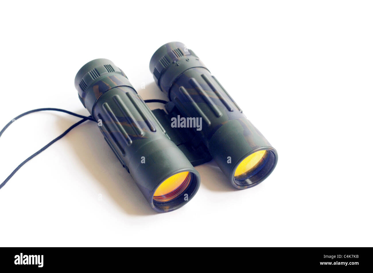 Closeup view of binoculars on a white background - Stock Image