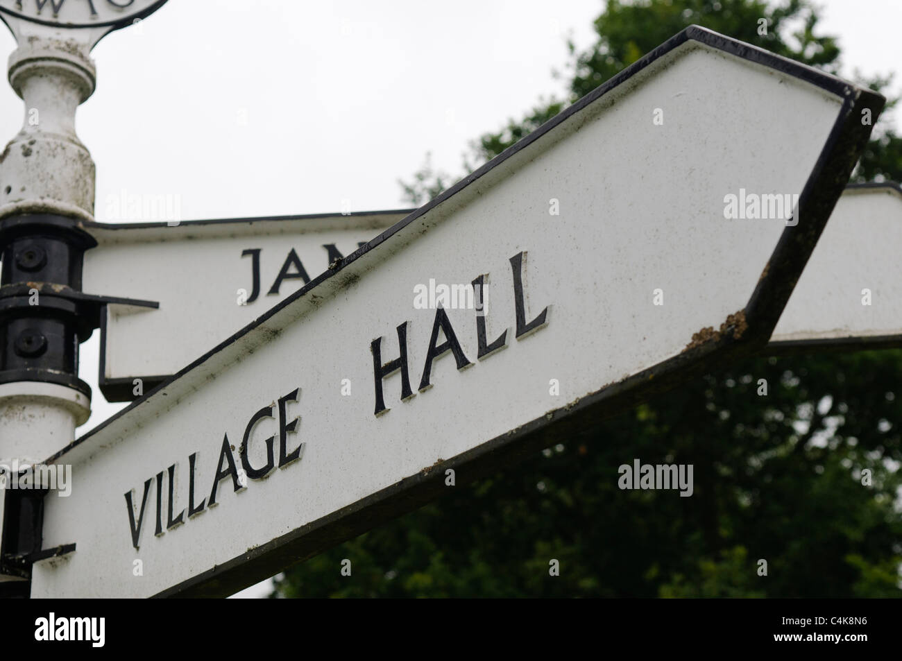 Sign pointing to the Village Hall - Stock Image