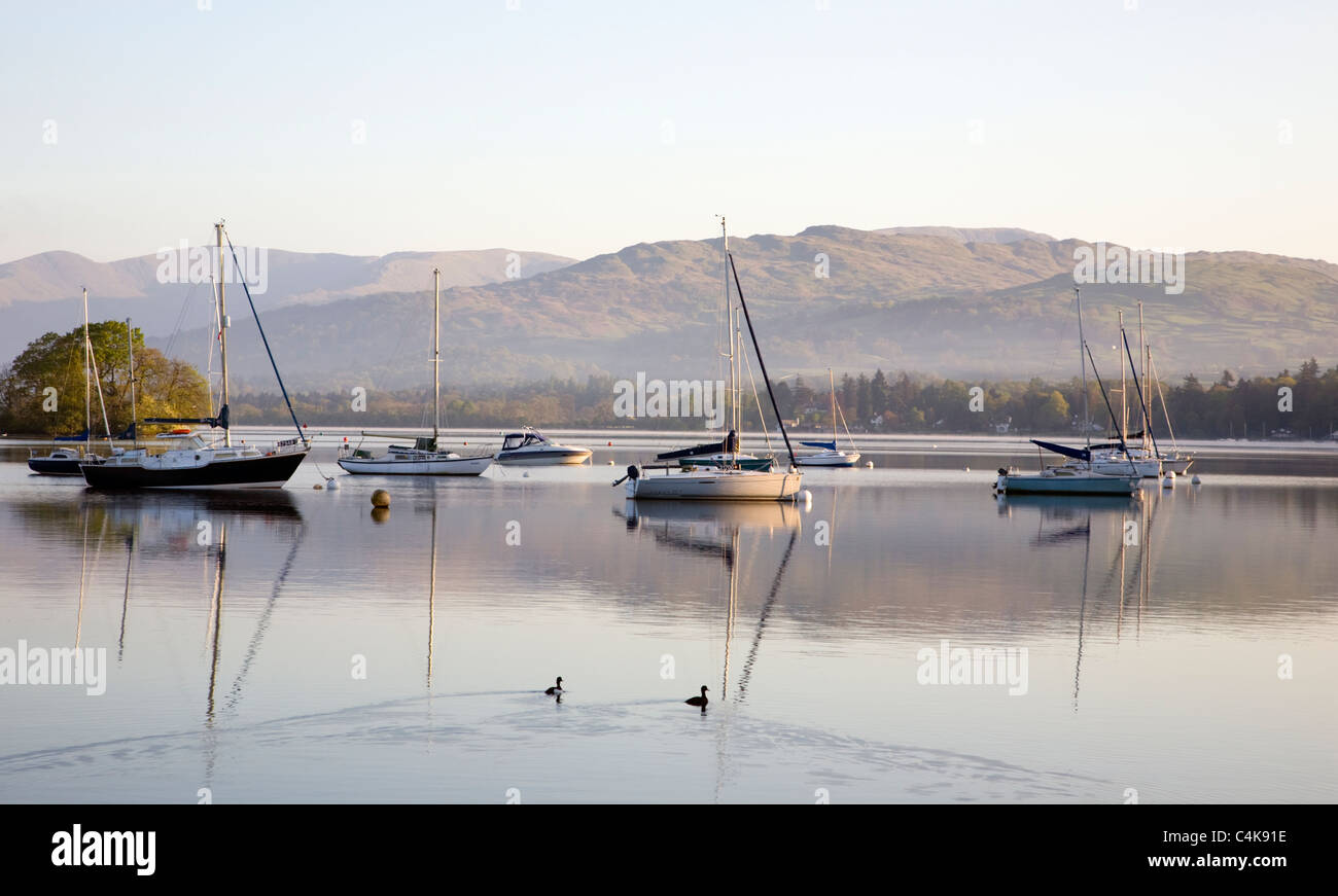 Boats and reflections on Lake Windemere - Stock Image