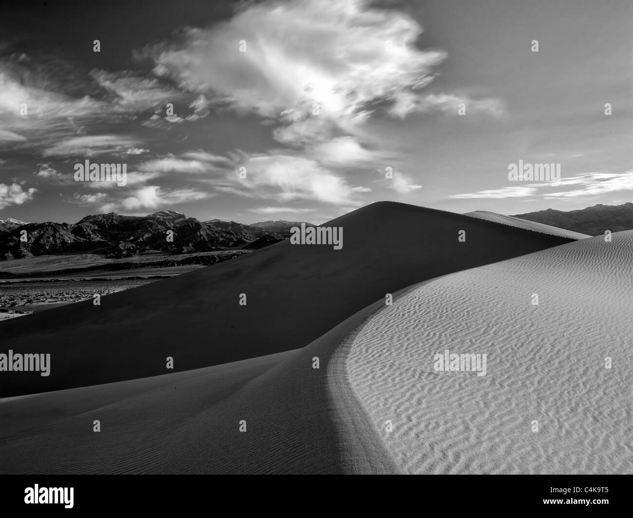 Clouds and sand dunes in Death Valley National Park, California - Stock Image