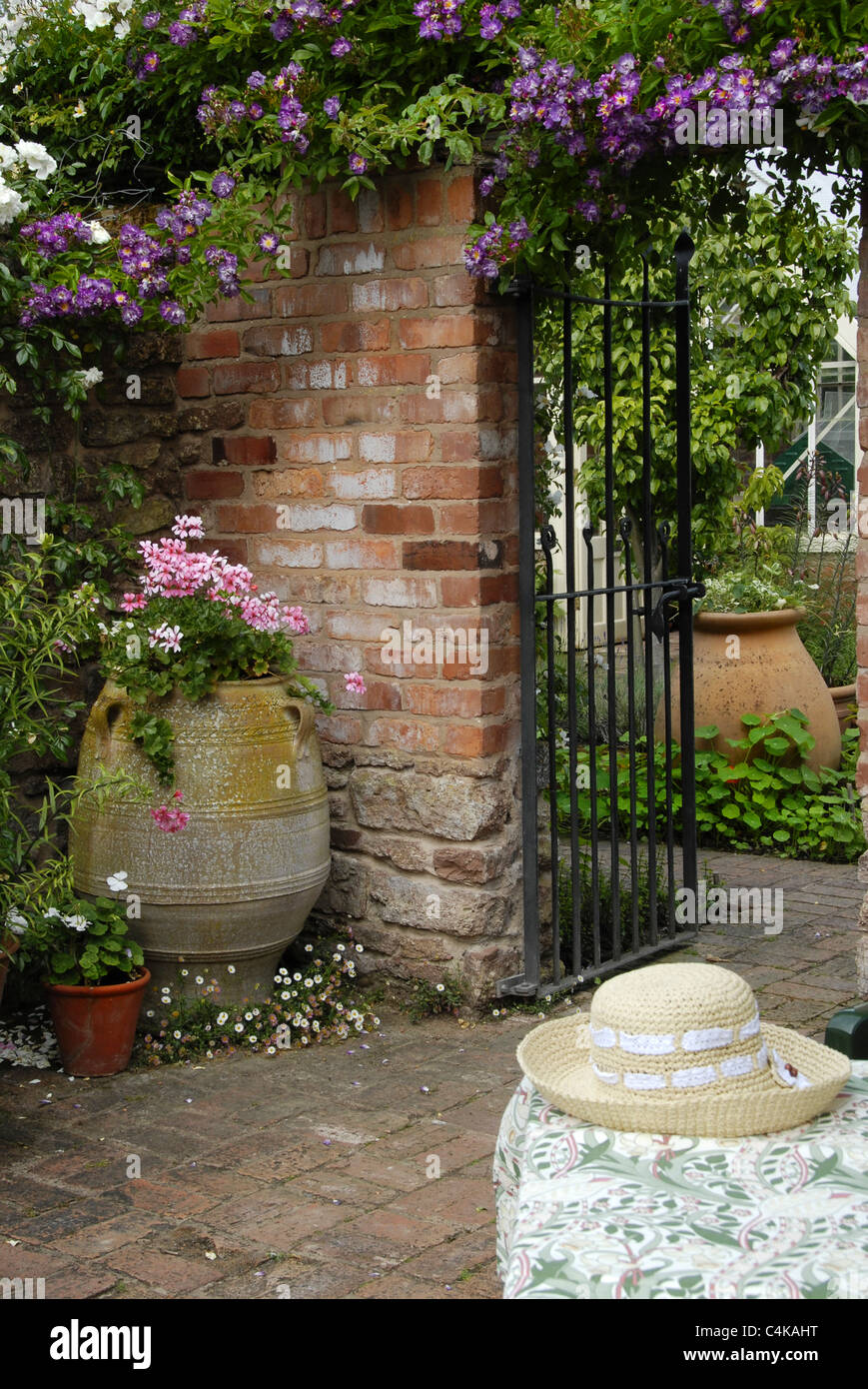 Portrait image of a typical English country garden with wall,garden ...