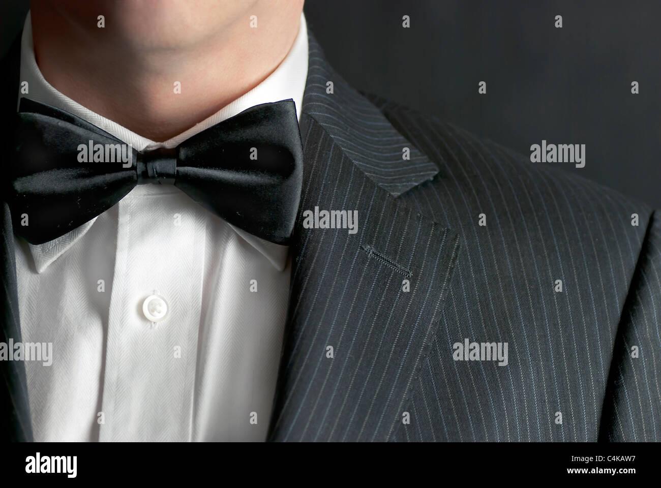 A close-up shot of a man wearing a tux. - Stock Image