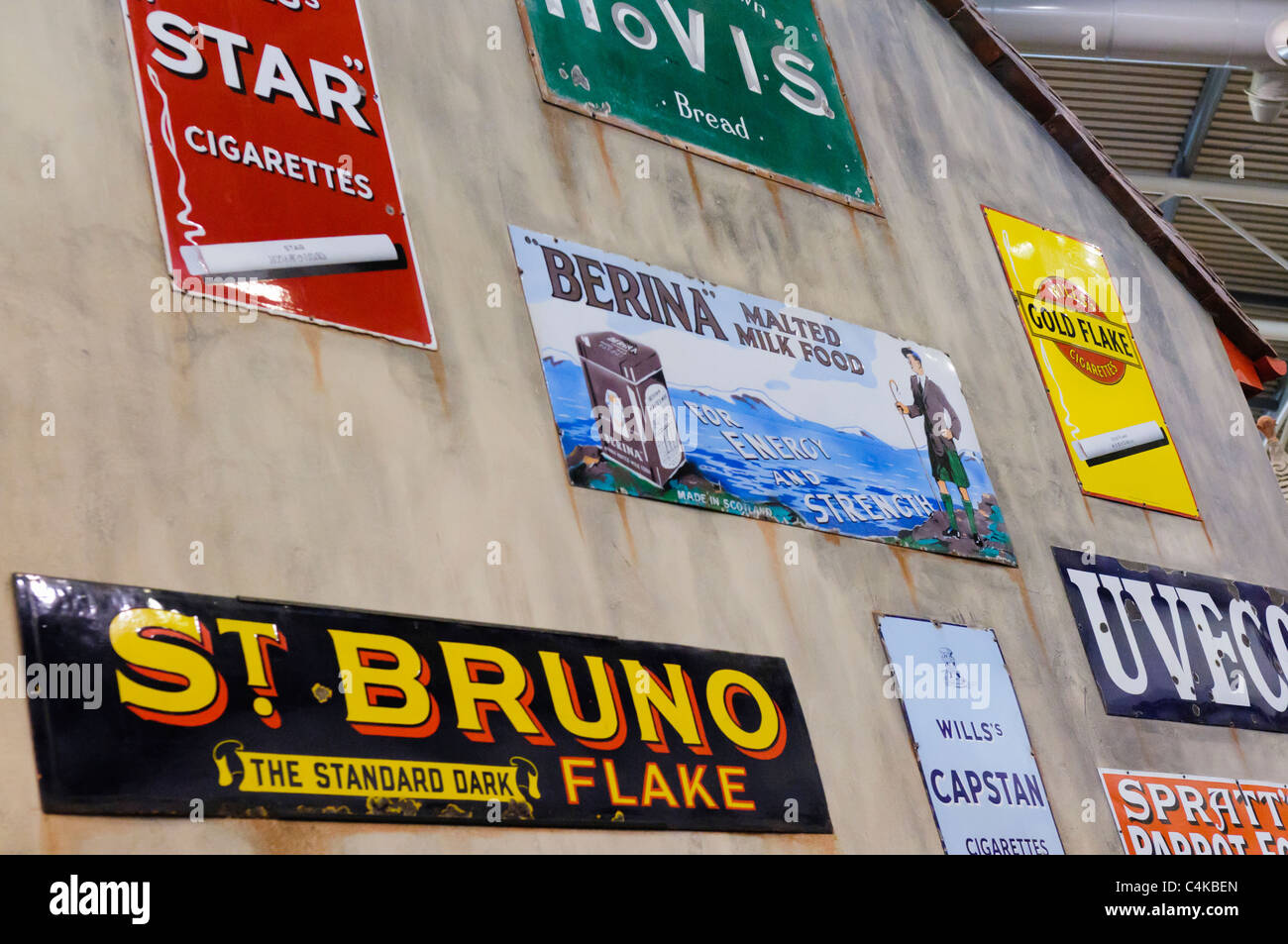 Tobacco and food advertising on the side of an old fashioned shop - Stock Image