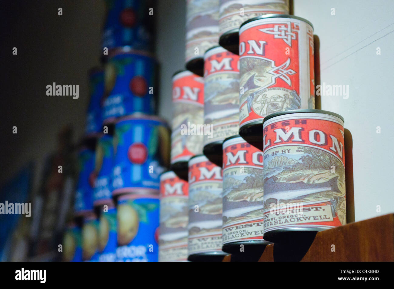 Tins of salmon stacked in a old fashioned grocers shop - Stock Image