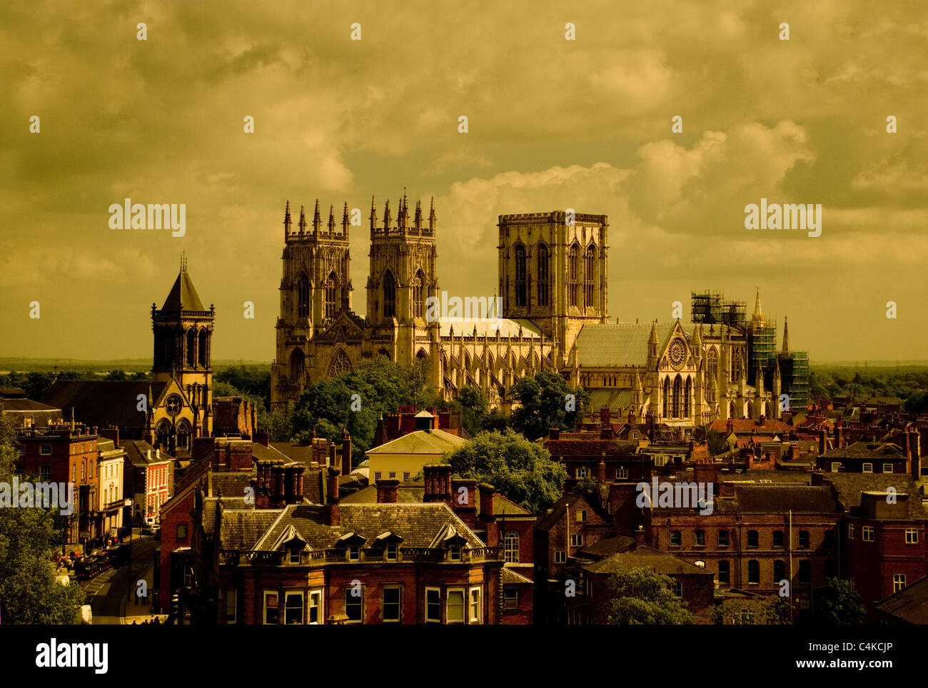 Landscape view of York Minster from high angle with heavy clouds in sepia tones - Stock Image