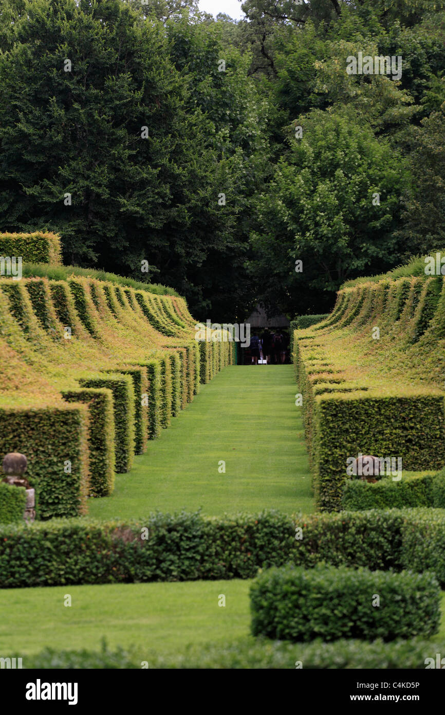 Formal topiary garden hedges in Gardens of the Manoir d'Erignac Salignac Dordogne Perigord France - Stock Image