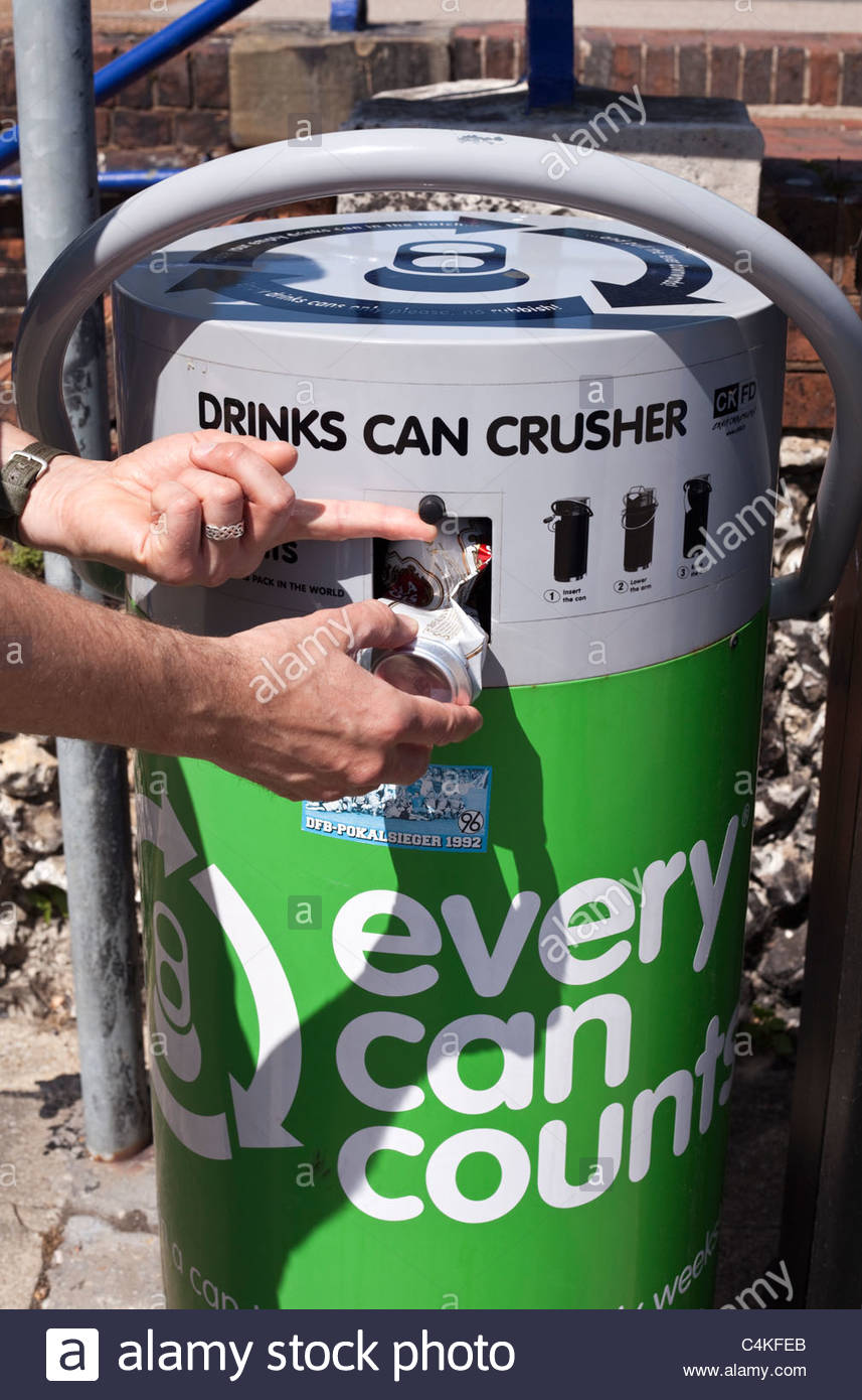 Person using a drinks can crusher - Stock Image