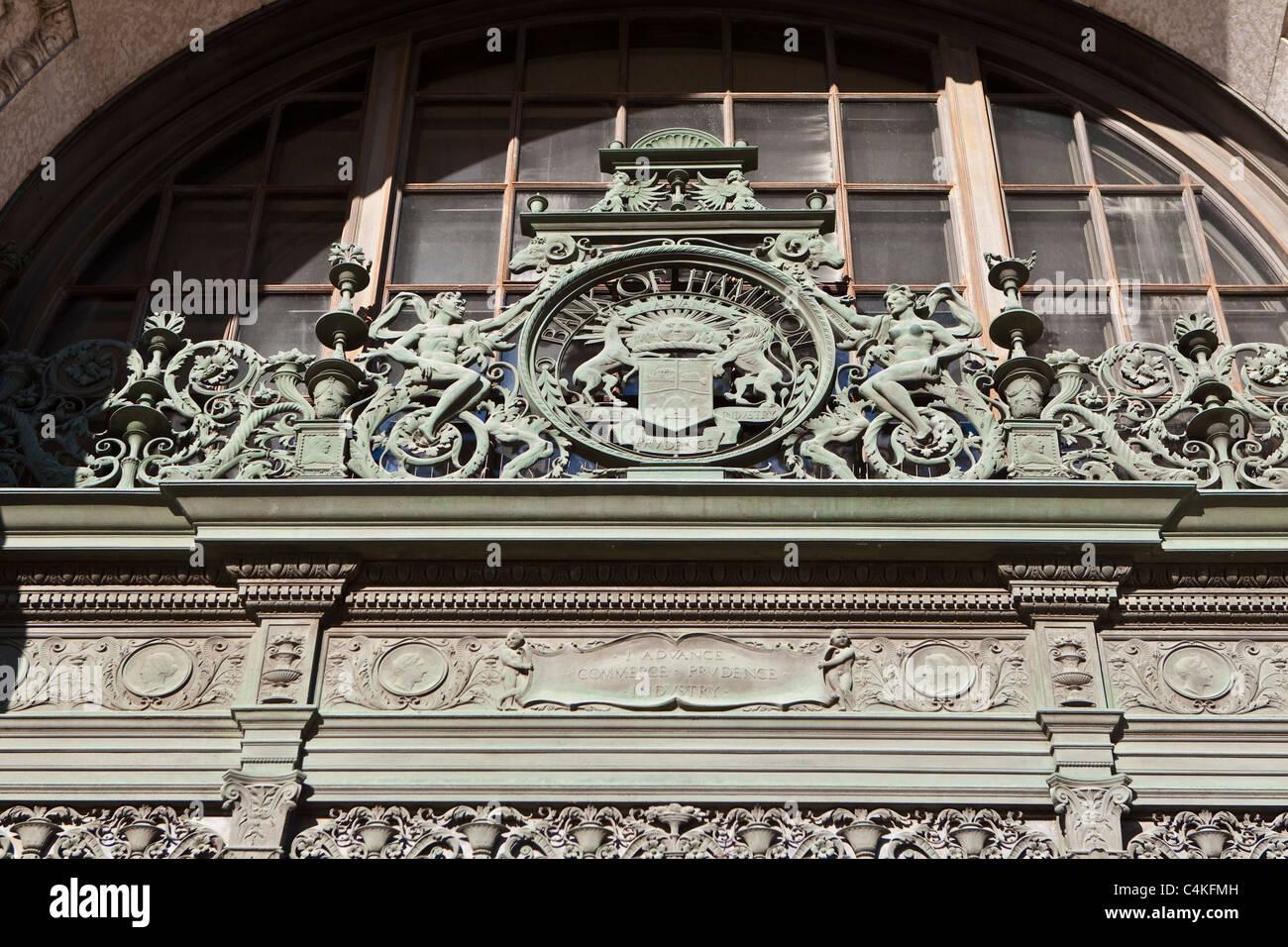 Details of an artwork above of a Bank of Hamilton door is seen in Winnipeg & Details of an artwork above of a Bank of Hamilton door is seen in ...