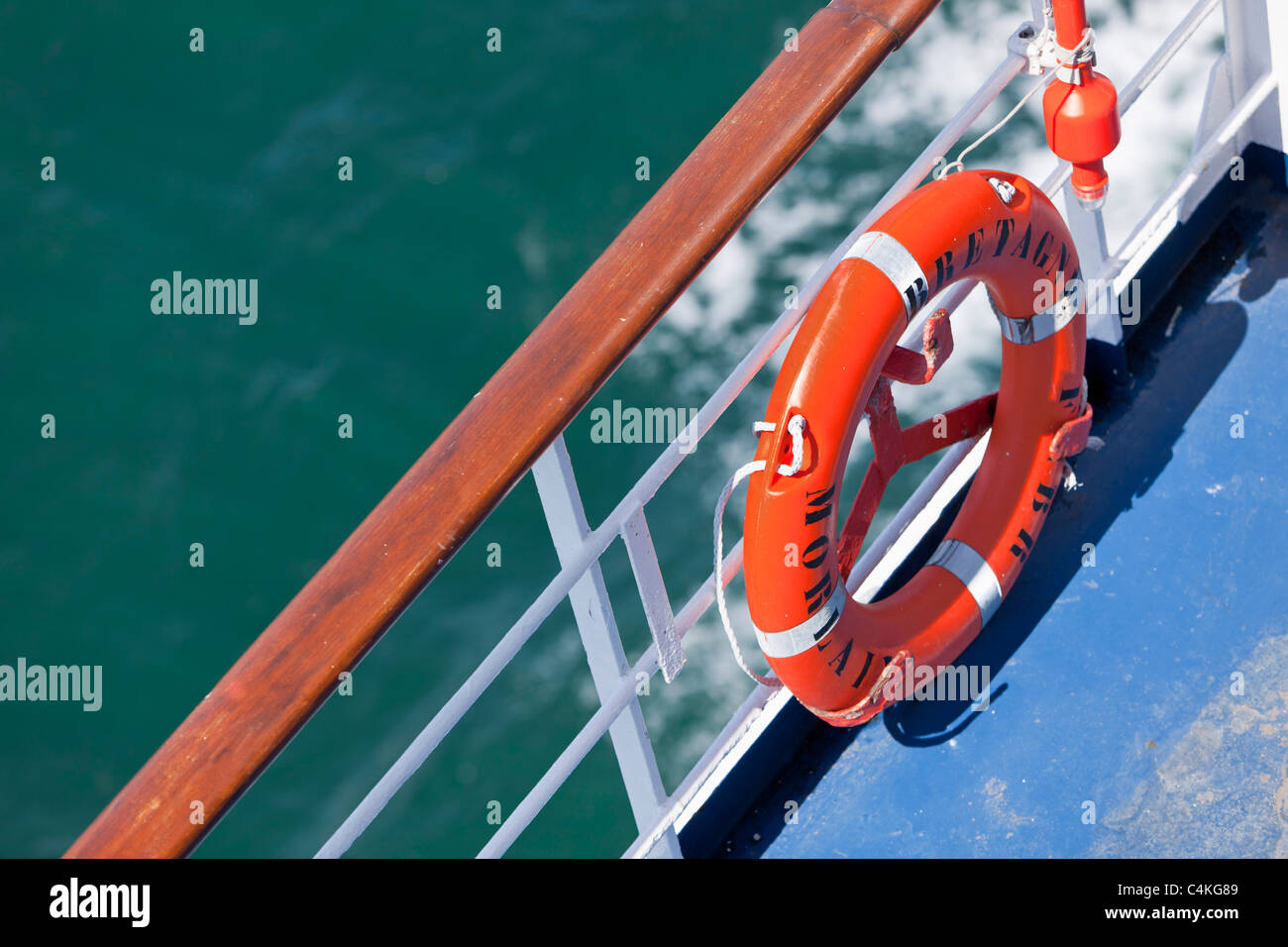 Lifebelt on the railings of a passenger ferry - Stock Image