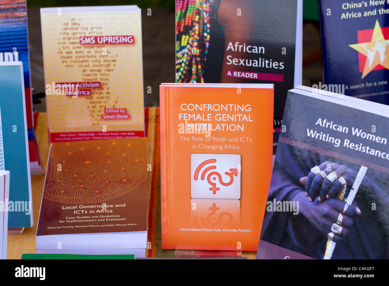 African Books, SMS Uprising, confronting female genital mutilation,  at Book stall selling paperback books at Africa - Stock Image