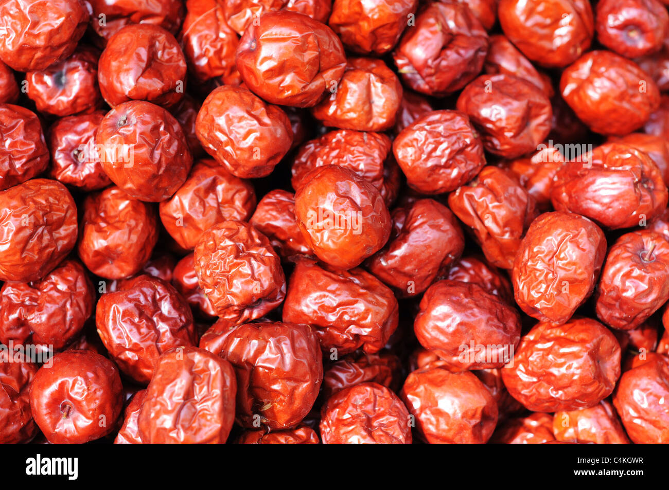 A pile of red Chinese date(or jujube) fruits in autumn. - Stock Image
