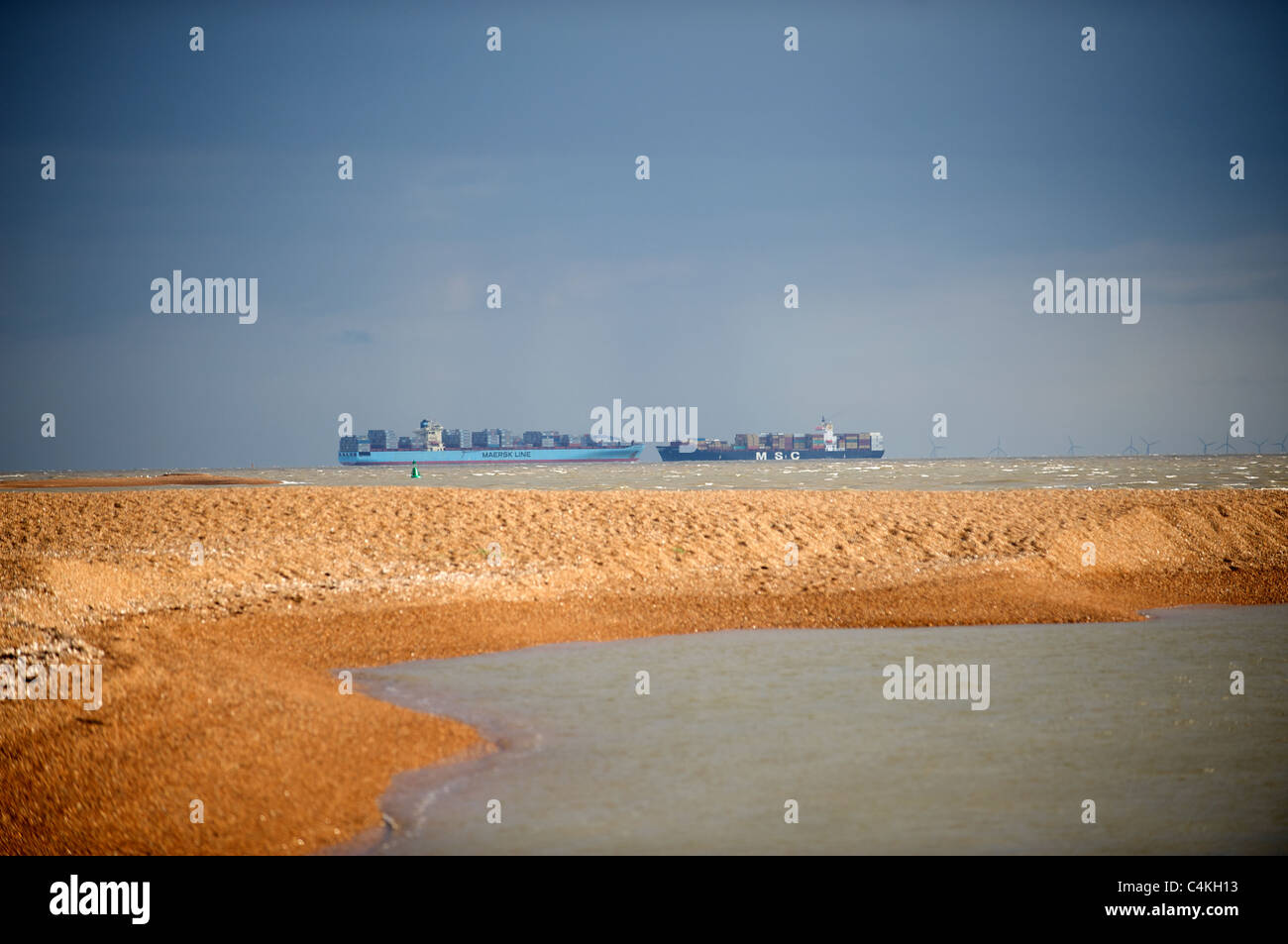 Containers ships passing in the North Sea close to the Port of Felixstowe, Suffolk, UK. - Stock Image