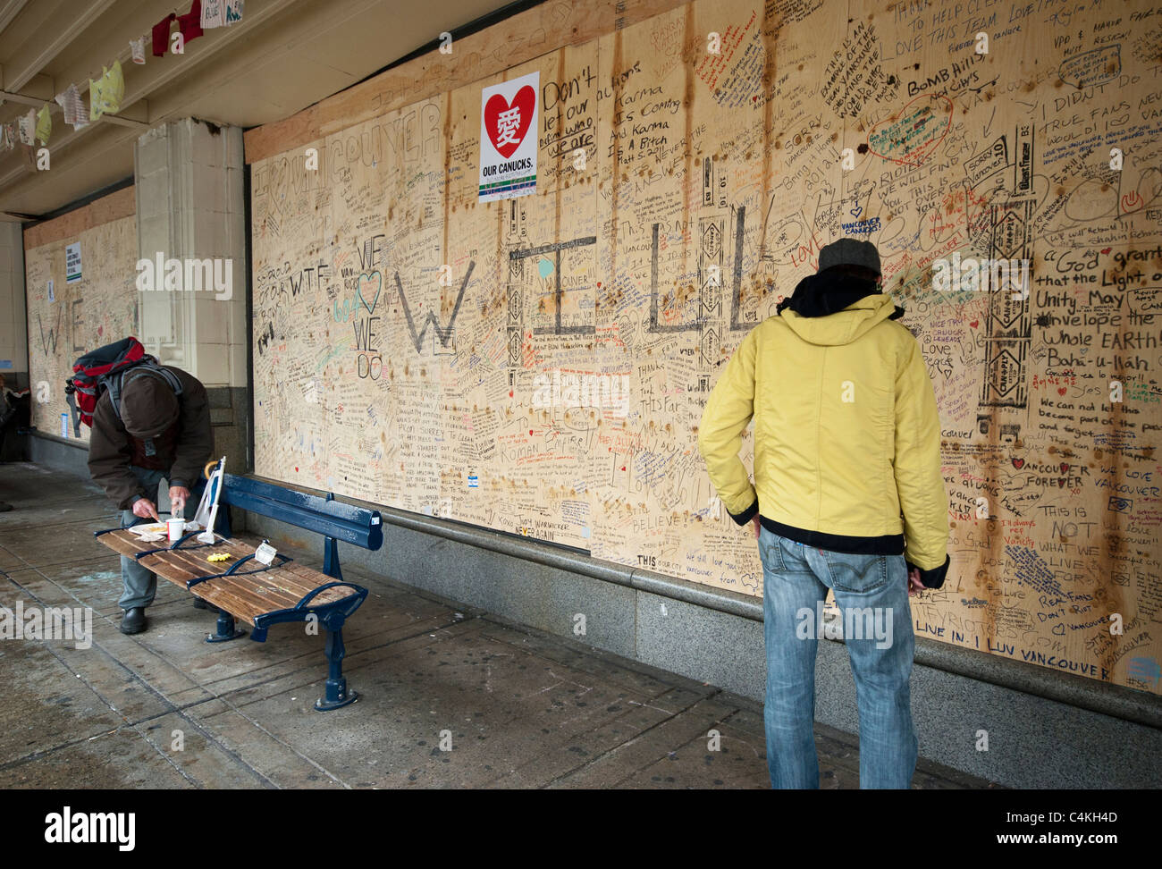 Boarded up windows with written messages at Hudson Bay store in downtown Vancouver after 2011 hockey riot - Stock Image