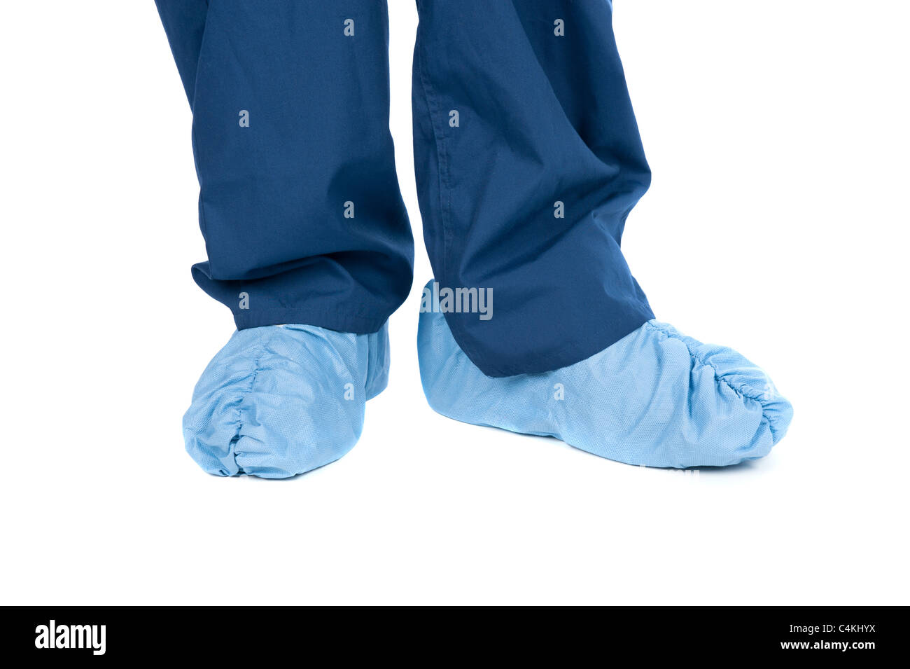 A doctor wearing protective medical scrubs and feet coverings. Stock Photo