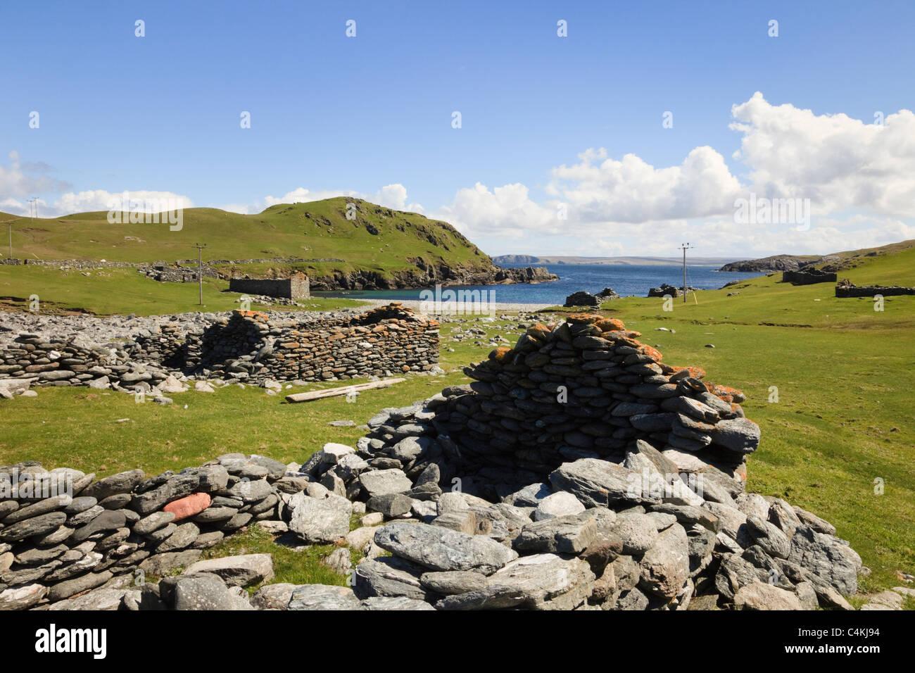 Derelict fishing lodges at old Haaf station heritage site. Fethaland, Northmavine, Shetland Islands, Scotland, UK - Stock Image
