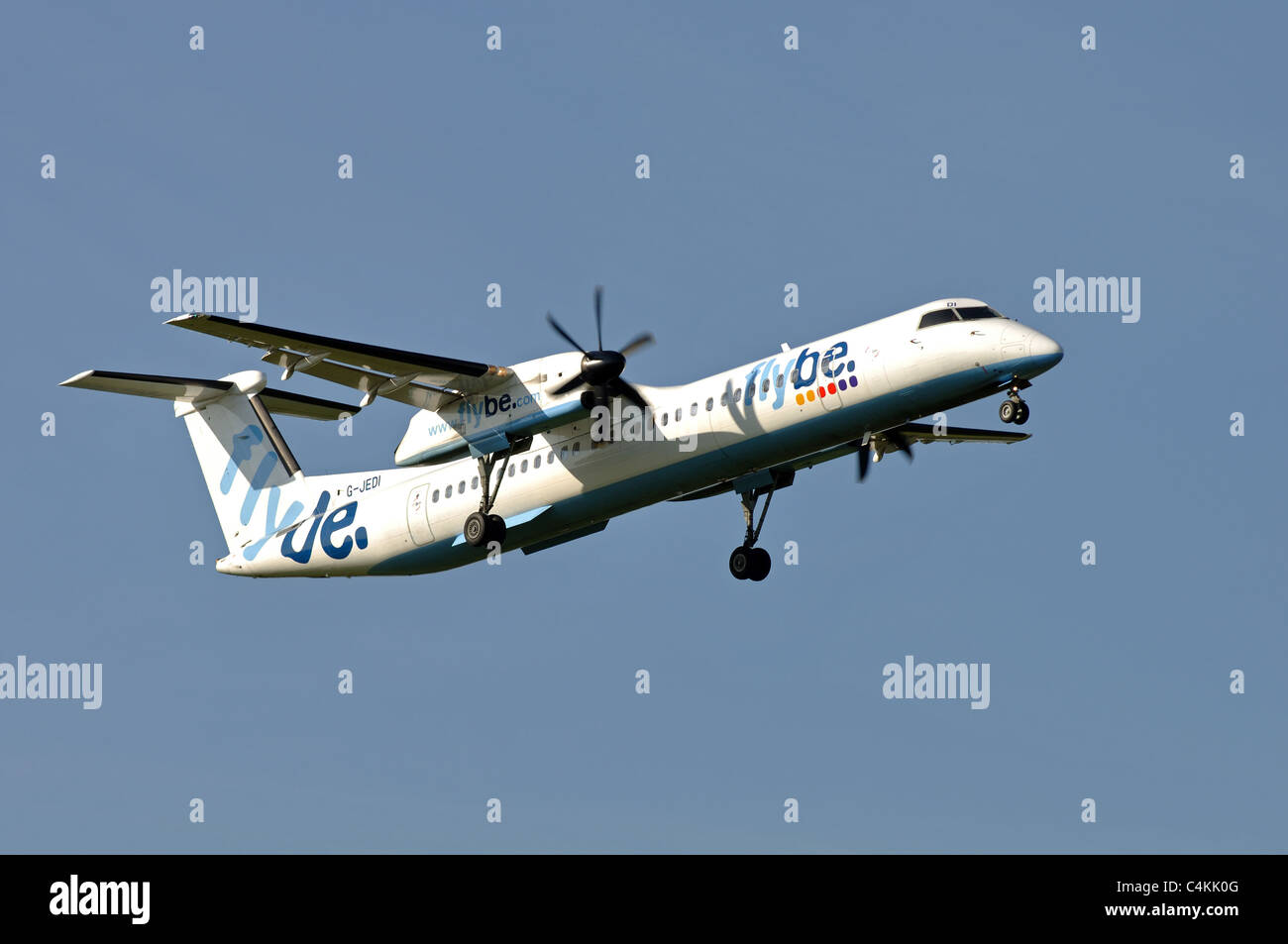 Flybe Dash 8 aircraft approaching Birmingham Airport, UK - Stock Image