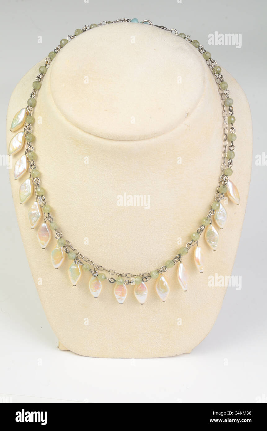 A necklace with shell on display - Stock Image