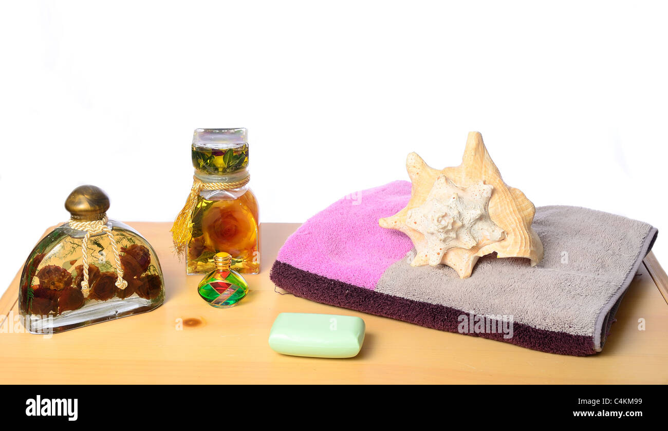 Bath oils, soap, towel, and seashell concept. - Stock Image