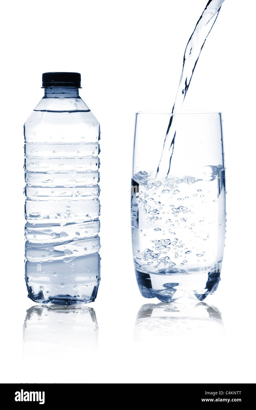 Mineral water in glass and bottle - Stock Image