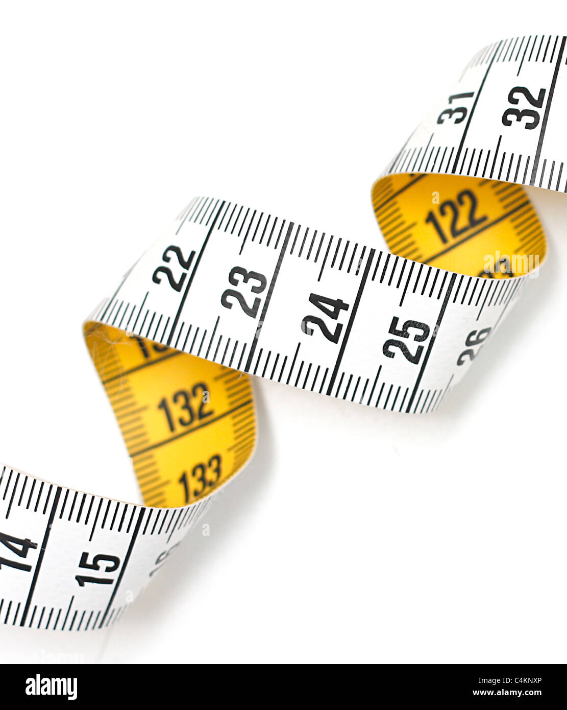 Tape measure isolated on white - Stock Image