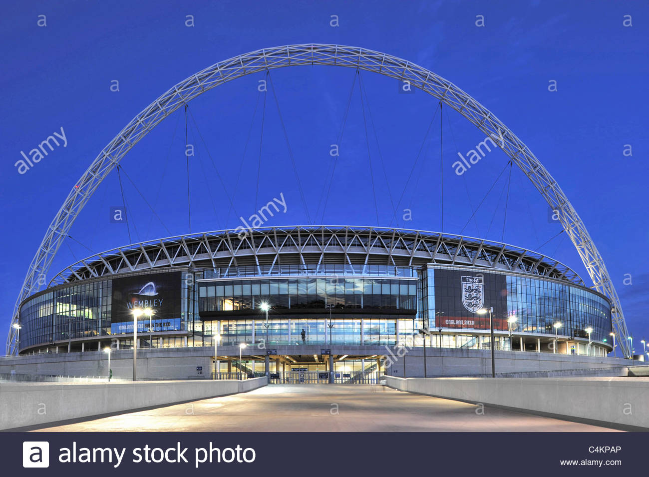 Wembley Stadium front illuminated at dusk, London England UK - Stock Image