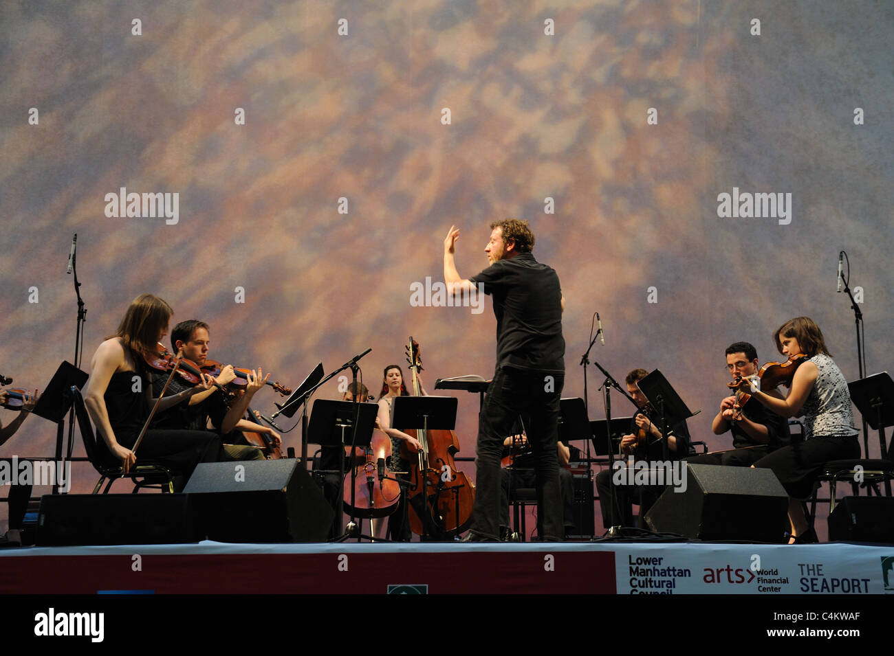 At the annual Bang on a Can marathon of contemporary music, Brad Lubman conducted the string ensemble Signal. - Stock Image