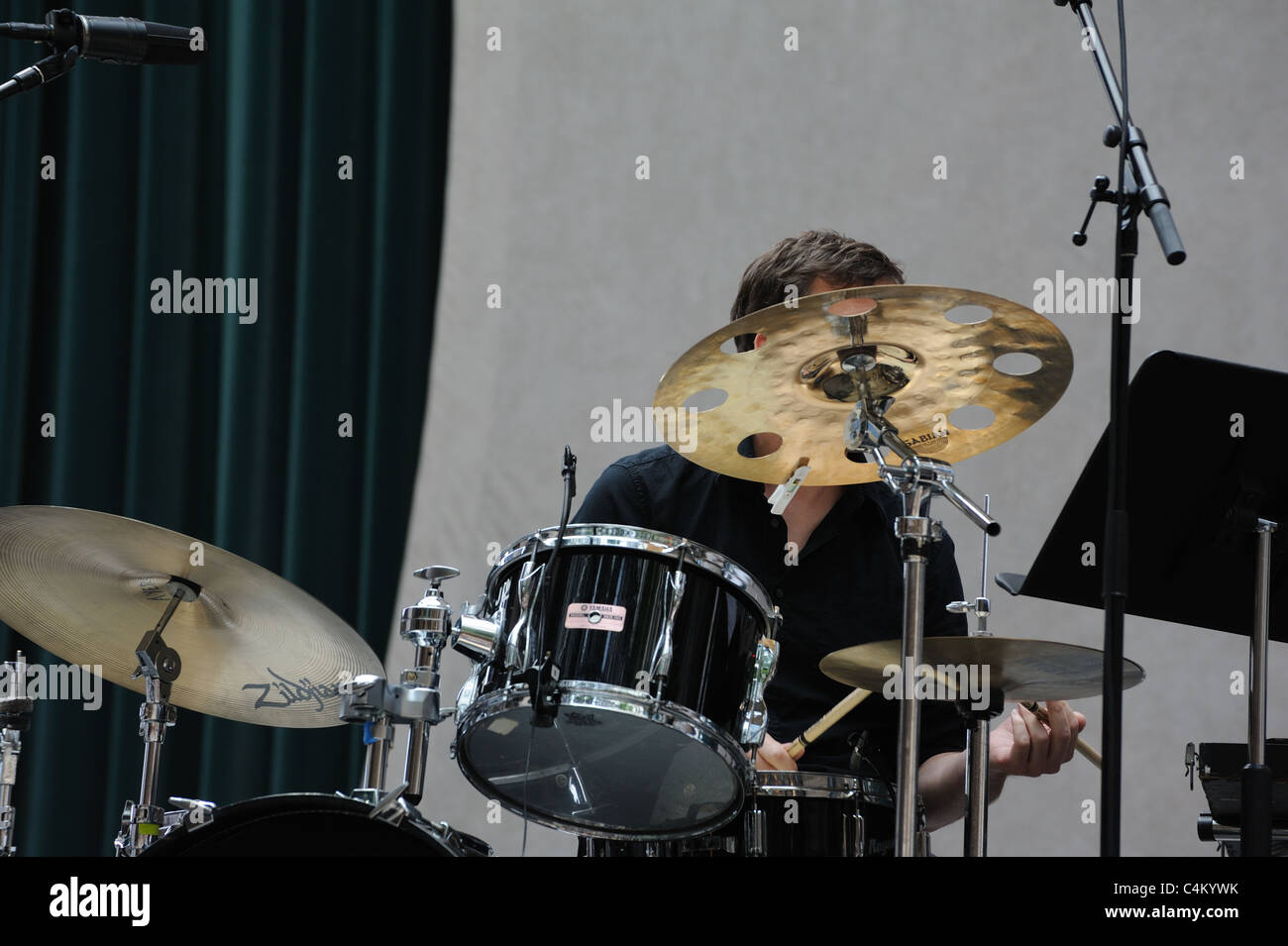 A drummer playing in the Bang on a Can marathon of contemporary music at the World Financial Center in Manhattan. - Stock Image